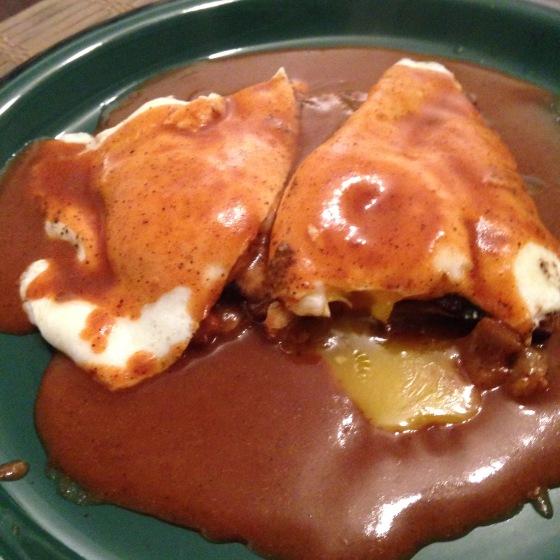 Leftover enchiladas, chile gravy, and fried eggs.