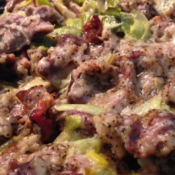 chicken gizzards cooked with bacon, leeks, cream, and mustard